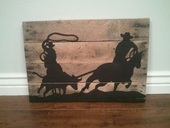 Cute rustic sign for a Western home! Or for a Cowboy themed bedroom!  Team Roper silhouette pallet wood sign by TheCreativePallet, $40.00