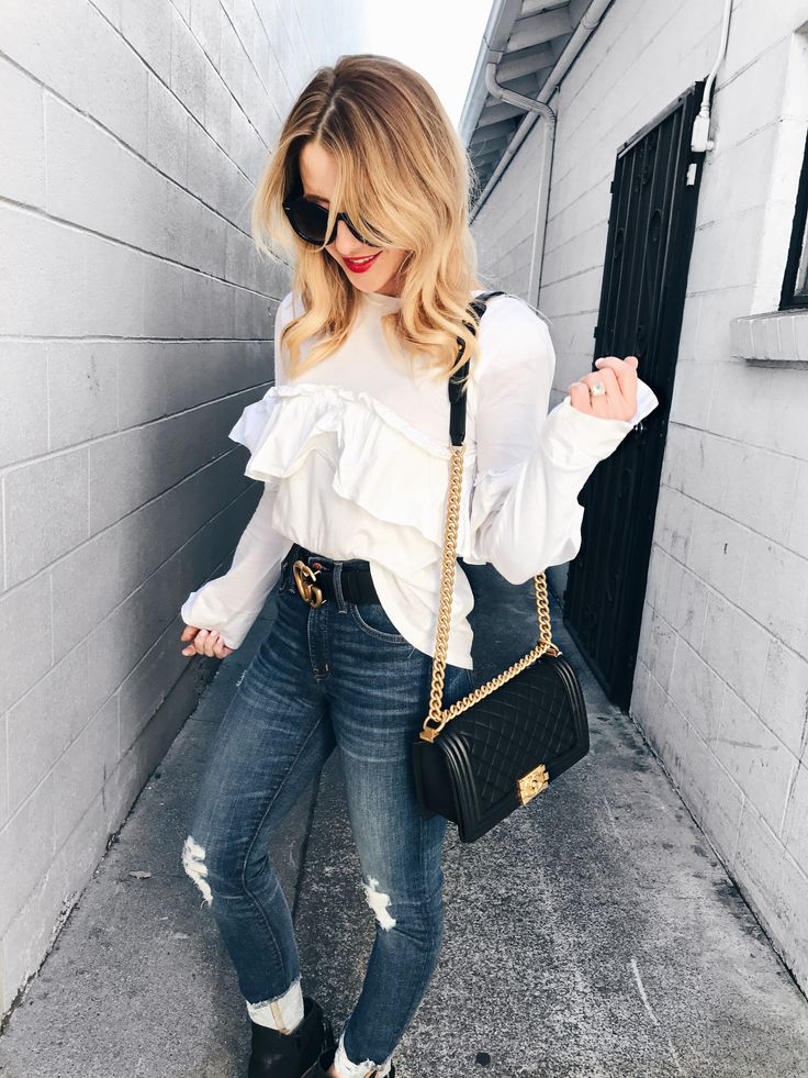 Distressed jeans + ruffled shirt.