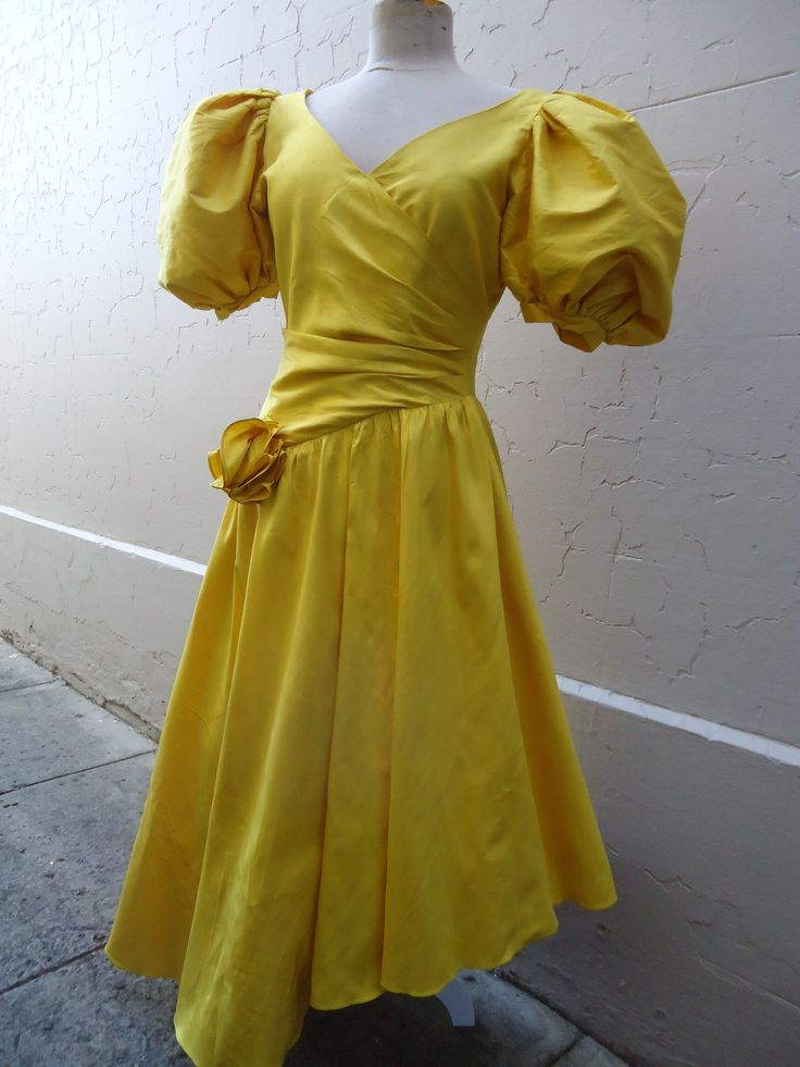 1980's puff-ball mania! Pure silk in Sponge-Bob canary yellow! Size 10 great condition. $85