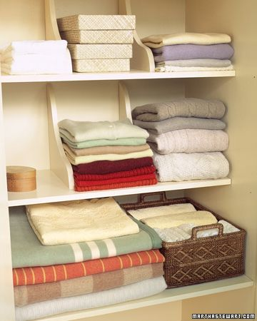 Closet - Store folded clothes in between shelf brackets to keep the piles from falling over