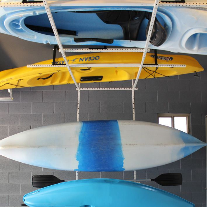 Motorized Horizontal Quad Kayak Lift White.  A great way to properly store your kayak, and save you space in the garage as well!