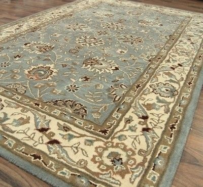 tabriz duck egg blue rug (I love this one - traditional but fresh. Would tie all the colours together beautifully and give a very settled look to the room I think). From £114