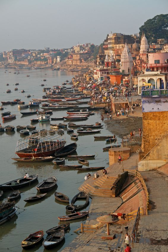 Varanasi, India on the banks of the river Ganges.  Apparently, this is the holiest place on earth.