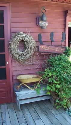 prim decorated porch. I could use dollar tree owls or crow! Paint my plastic wheelbarrow ? Teal? Add some mums