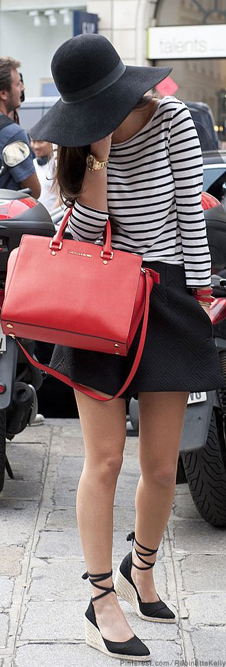 Black and white shirt mini skirt with shoes and red handbag