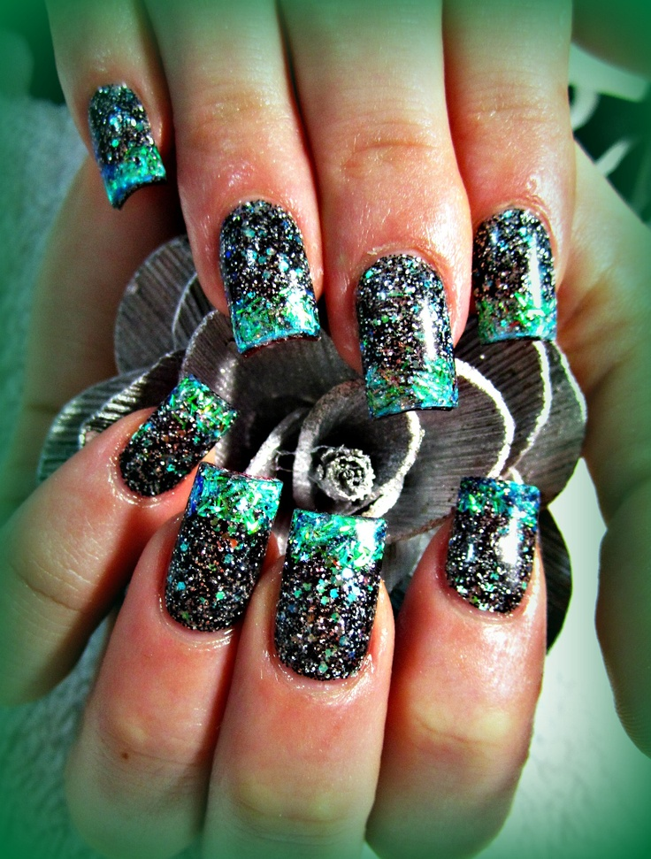 black and teal acrylic nails