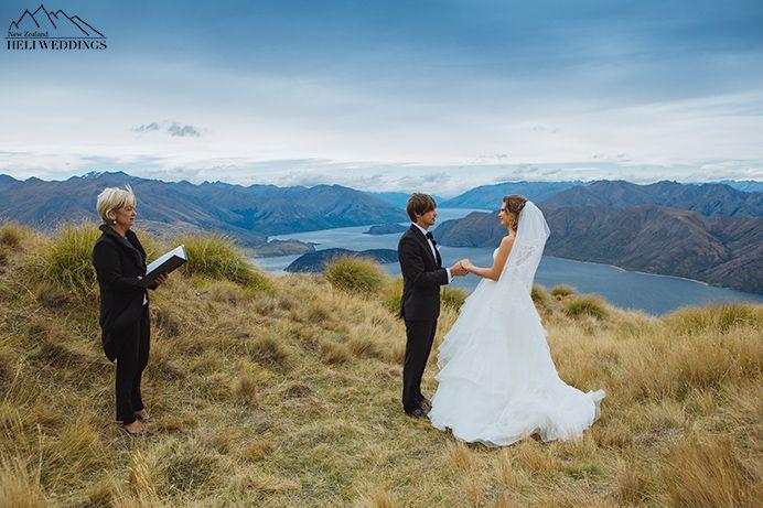 Bride and groom exchange vows at Coromandel Peak wedding. Heli wedding Wanaka New Zealand