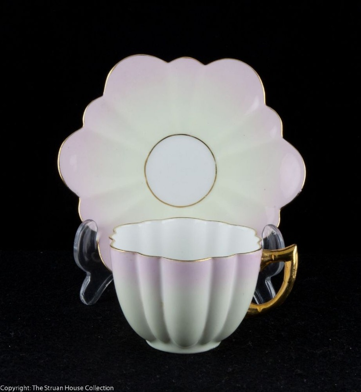 A delightful demitasse coffee cup and saucer made at the turn of the 19C in the very pretty and collected Daisy shape The rims and handle are gilded