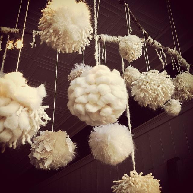 "Window display of ""snowball"" pom poms by Modern Fiber Lab - Sonya Yong James, via Flickr"