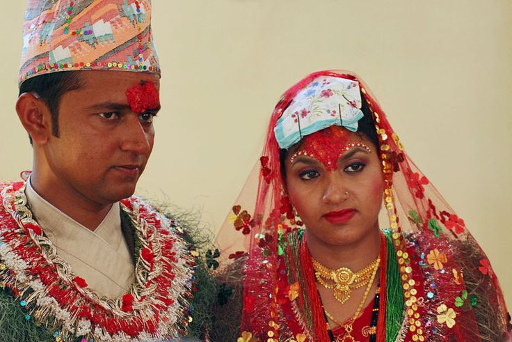 Bride and groom pose for photos in Chitwan, following an hours-long Nepali Hindu wedding ceremony