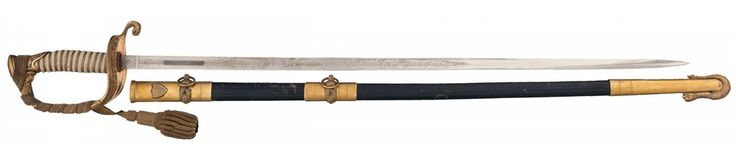 N.S. Meyer U.S. Coast Guard Officer's Presentation Sword. 293/4in. single fuller blade, with decoration on each side, Meyer's N.Y. address on the left ricasso, and 'Rudy Vallee' in a panel on the right side of the blade. Gold washed hilt. Tumblr