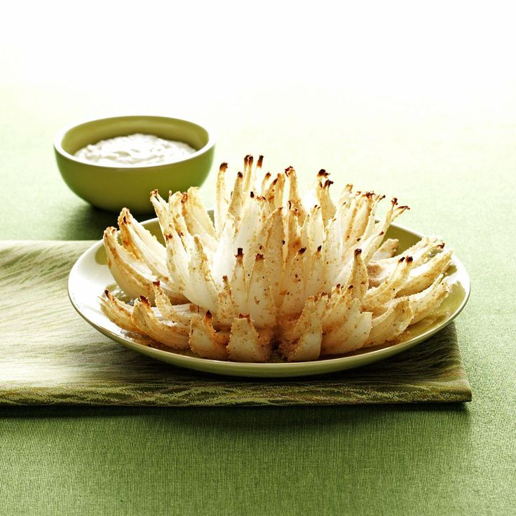 Blooming Onions Recipe -Instead of being battered and deep-fried, this onion is brushed with melted butter and mustard, sprinkled with bread crumbs and seasonings and baked. It's an impressive-looking appetizer, and the dip can be used for veggies and crackers, too. —Kendra Doss, Kansas City, Missouri