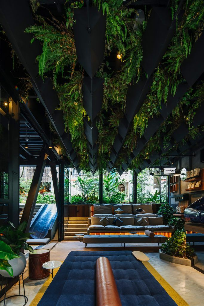 Plants Cover Grey Steel Of Hotel Click Clack Medellin By Plan B Arquitectos In 2020 Concrete Bench Hotel Lobby Planter Cover