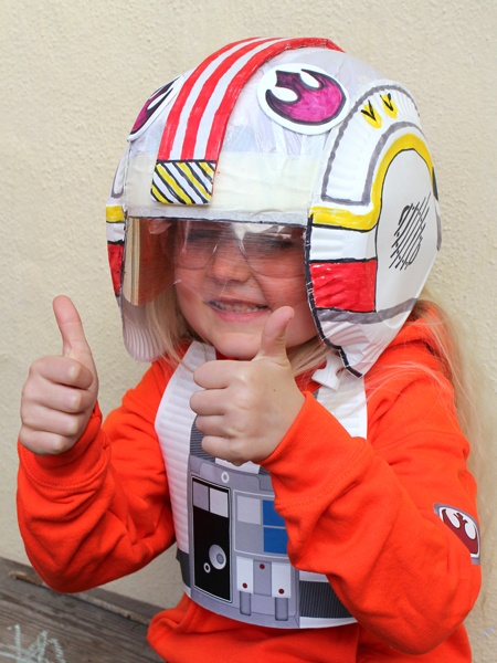 Kid's DIY Star Wars X-wing fighter pilot's helmet using a bicycle helmet (not permenantly attached but you could always make it permenant)