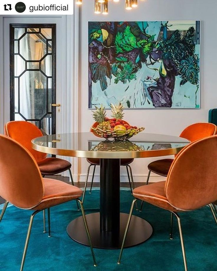 Dinning  decor inspiration: Visually dinamic colorful and dramatic perfect for dinner time repost @gubiofficial  The Beetle Chair shines in French apartment! Gorgeous teal tones contrasting against bright oranges to create a fantastic space. Photo by Gérard Faivre Paris  #gubiofficial #gubistore #beetlechair #gamfratesi #MO16 #dinningroom #luxuryis #lxcostarica #luxury #lifestyle #inspiration #decor #interior #luxuryinteriors #lxcostarica