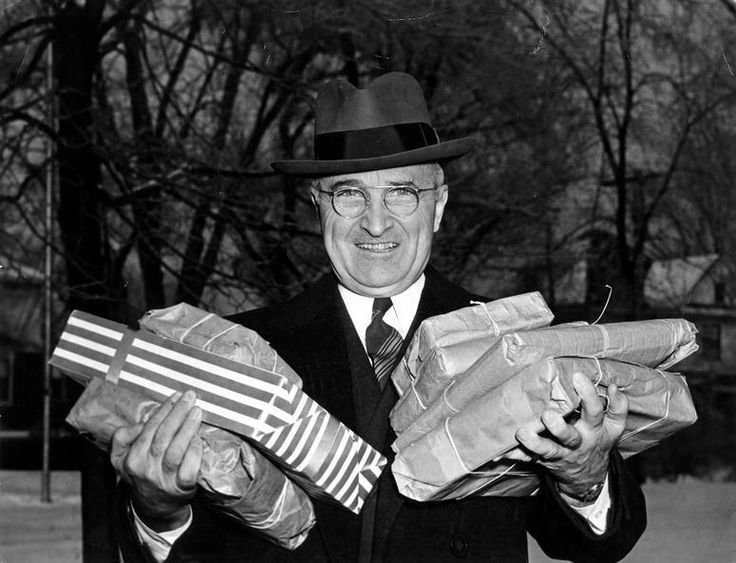 President Harry S. Truman with Christmas packages on a trip home to visit family in Independence, Missouri. December 25, 1945. (Photo: Harry S. Truman Library and Museum)