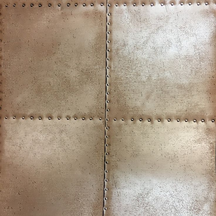 A riveted copper plate effect wallpaper from the Oxford collection. Create a rustic industrial look for any room with this copper sheet metal and studs design. It's paste the wall too, making it quick and easy to hang without the need for a paste table.