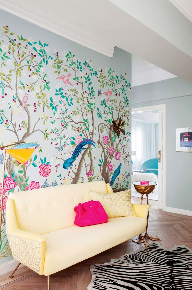 pastel yellow couch and beautiful wallpaper
