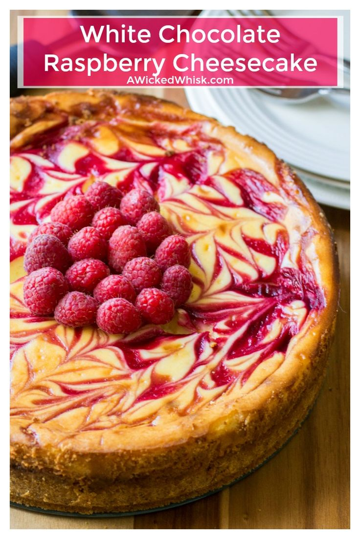 White Chocolate Raspberry Cheesecake is the perfect twist on your favorite cheesecake dessert. Creamy white chocolate and tart raspberry sauce help make this White Chocolate Raspberry Cheesecake the best cheesecake you will ever have! | A Wicked Whisk | https://www.awickedwhisk.com #cheesecake #whitechocolateraspberrycheesecake #raspberrycheesecake #whitechocolatecheesecake #dessert #summerfood #fourthofjulydessert #fourthofjulyparty #easterdessert #mothersdaydessert