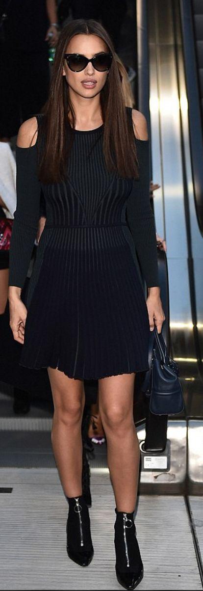 Who made Irina Shayk's black cut out dress, zipper ankle boots, and handbag?