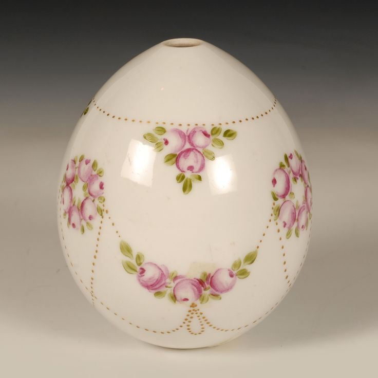 A Russian porcelain Easter egg, circa 1900. The egg painted with a polychrome floral garland on a white ground.