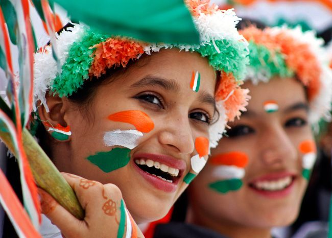 Schoolgirls dressed in the colors of tricolor participate in rehearsals forIndependence Day celebrations in Ajmer on August 13, 2014.