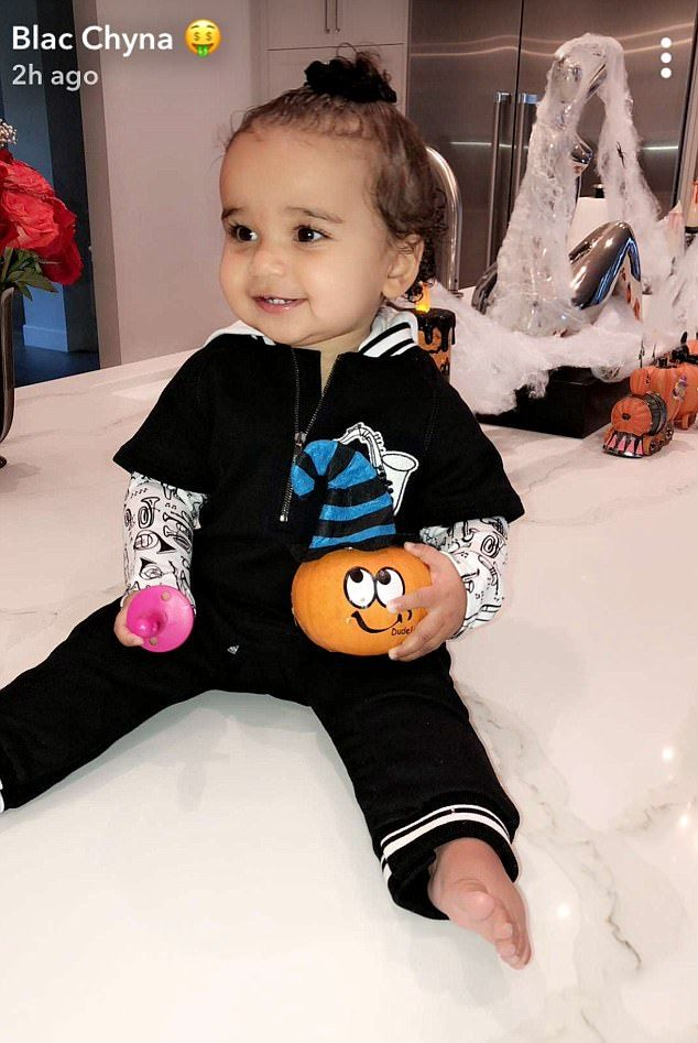 Blac Chyna's daughter Dream plays with Halloween pumpkin | Daily Mail Online
