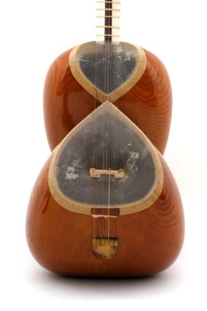 The tar is a traditional Persian instrument that uses mulberry wood and stretch lambskin and camel leg bone. It has a range to of 2 to 1 1/2 octaves and has 25 to 28 adjustable gut frets. The pairs singing strings are tuned in fourths of C G C and then the one flying bass string which is tuned in G, an octave lower than the singing middle string.