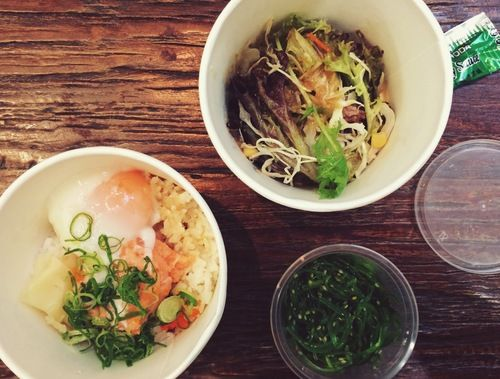 salmon rice bowl with soft-boiled egg, mixed leaf salad with wafu dressing and a seaweed salad