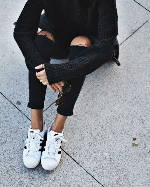 I love big loose chunky sweaters with skinny jeans. I like the distressed  look and the adidas shell toes.