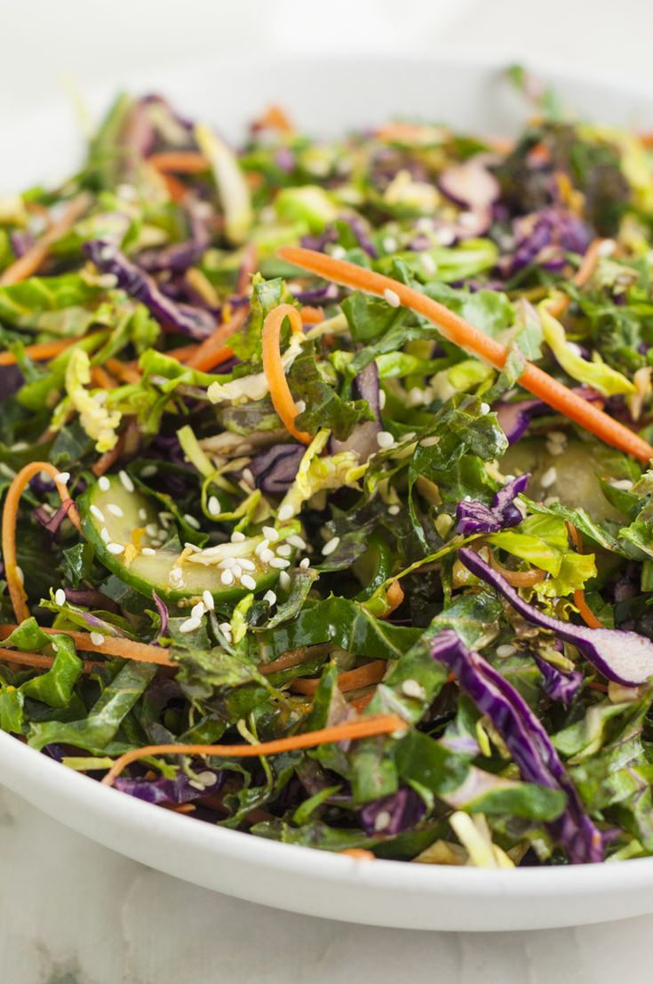 Looking for a kale salad recipe that is super satisfying and doesn't taste too bitter? This sesame kale salad with ginger soy dressing recipe is perfect!