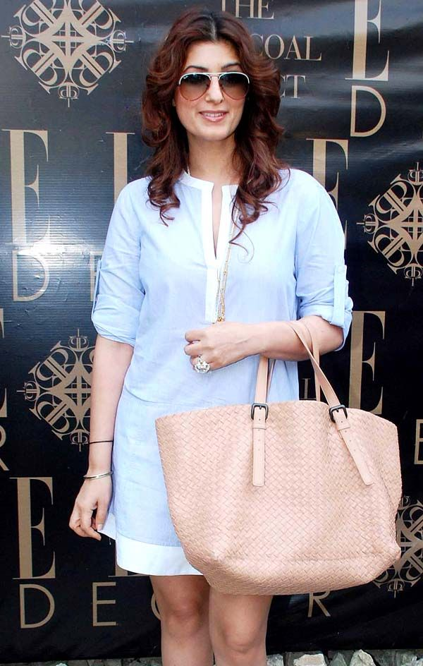 Twinkle Khanna looked chic in her light blue dress and beige handbag at the launch of Sussanne Khan's lifestyle store. #Bollywood #Fashion #Style #Beauty #Page3