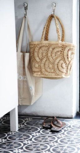 straw bags and the wonderful tile floor