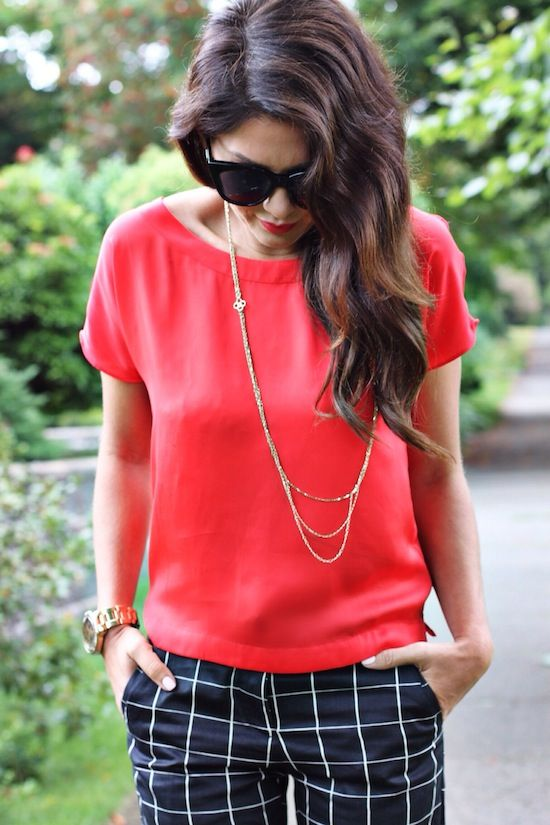 Windowpane pants with a bright short-sleeved sweater and long necklace. Simple but pulled together