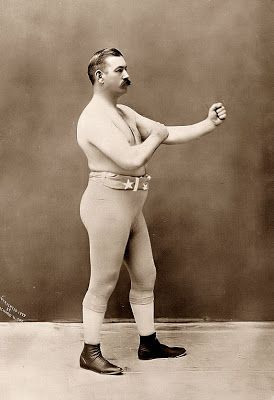 This is a photograph of John Sullivan, a prize fighter of the late 1800's. He was one of the last heavyweight champions of bare-knuckle boxing. This photo was taken in 1898.