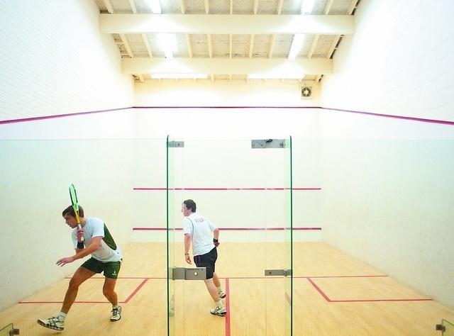 Undergraduate students playing squash, Sports Centre, University Park