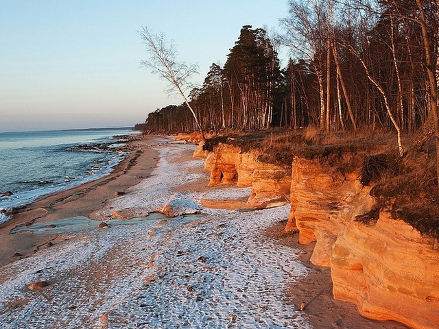 My mother's favorite past time - walking along the Baltic Sea. Beach in winter along the Baltic Sea, Latvia.
