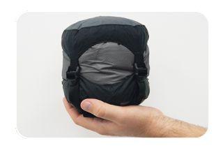 "Sea To Summit's ""Micro MC II""  sleeping bag:  weighs just 1lb 3oz, scrunches up smaller than a half-gallon of milk: www.backcountry.com/sea-to-summit-mcii-sleeping-bag-36-degree-down"
