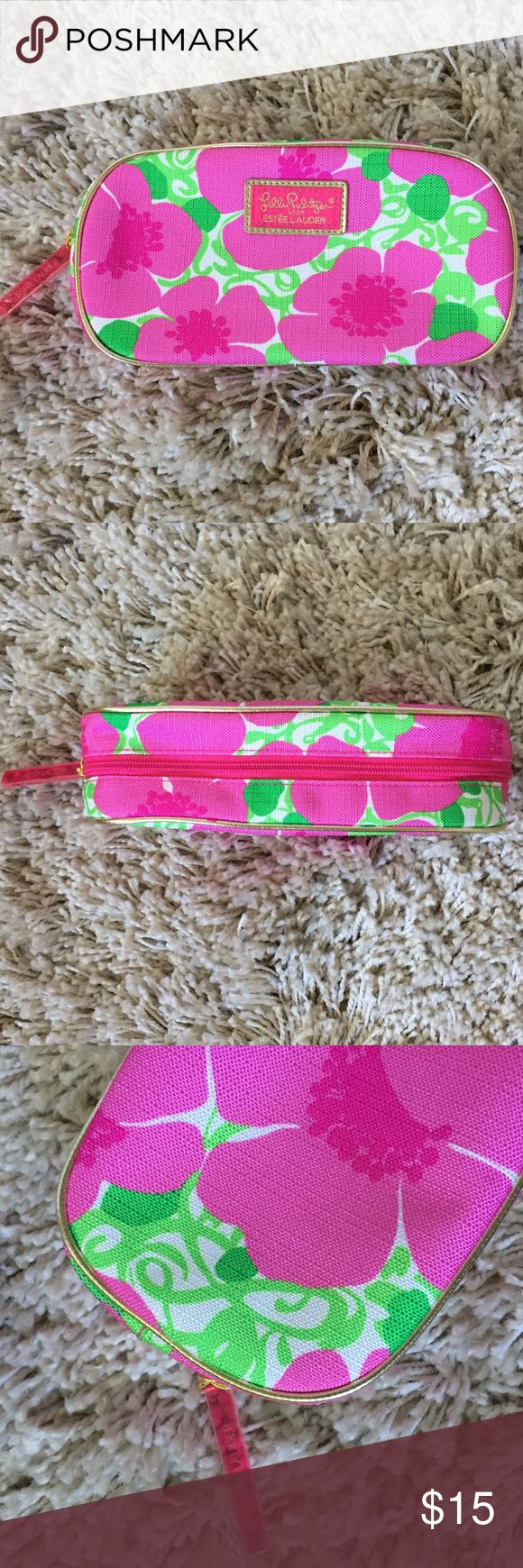 "🆕🌷 Lilly Pulitzer Makeup Bag + Lilly Pulitzer for Estée Lauder makeup/accessories bag 👛💄 + Never been used!  + Measures: 9"" x 4.75""  ⭐️All items are steamed cleaned and shipped within 48 hours of your purchase.   ⭐️If you would like any additional photos or have any questions please let me know.  ⭐️Sorry, no trades. But will listen to ALL fair offers. Thanks for shopping! Lilly Pulitzer Bags Cosmetic Bags & Cases"