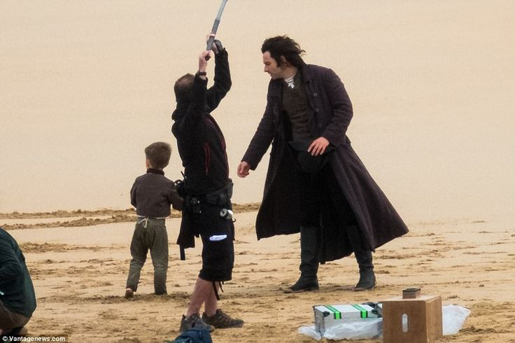 Father and son time: Aidan looked focused as he filmed with his on-screen son Jeremy