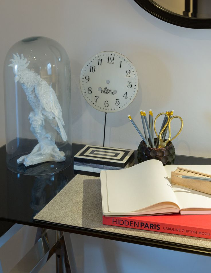 We dressed this trendy Islington apartment with a display of quirky accessories, the faux fur place mat sitting beside the white cockerel statue, geometric box and handless clock.