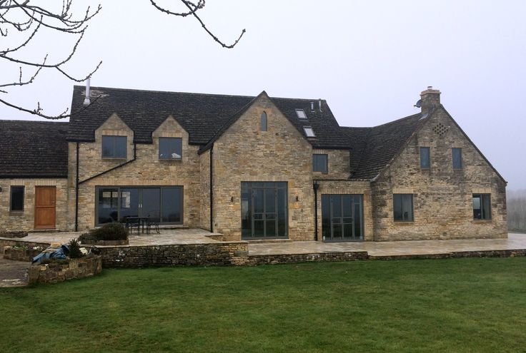 Aluminium windows and doors fitted into Cotswold stone building, Gloucestershire.
