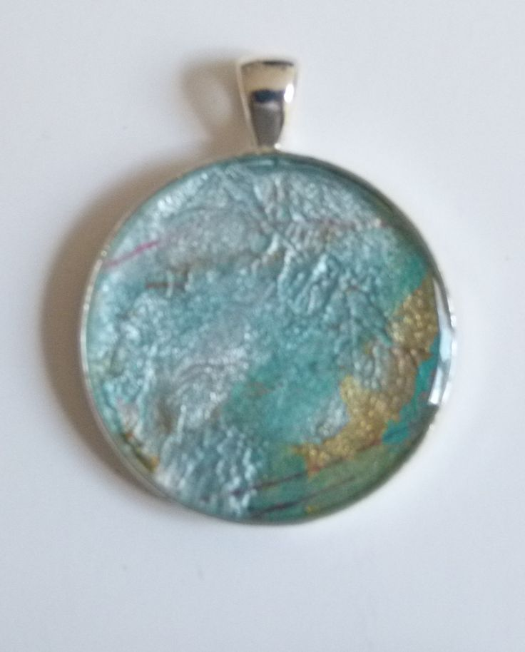 """Shimmering Haze"" - watercolour, plus metallic powders, set in a silverplated pendant case, resin shining on the surface. See it at jackiesimmondsstudio - my Etsy shop"