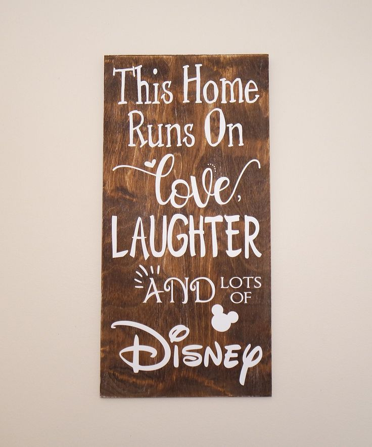 This Home Runs On Love Laughter and LOTS of Disney Wooden Sign, Disney Sign, Shabby Chic Disney Quote Sign, We Do Disney, Home Decor, Sign. This wooden sign is approximately 12 x 24 x 3/8 inches in size. The board is aged for a shabby chic/reclaimed wood look. The graphic is done in white vinyl. We offer this sign in Black Stain, Brown Stain, and Distressed Wood. Each wooden board is a bit different. This is the perfect Home Accent for Disney Lovers! :) We offer this sign with or without…