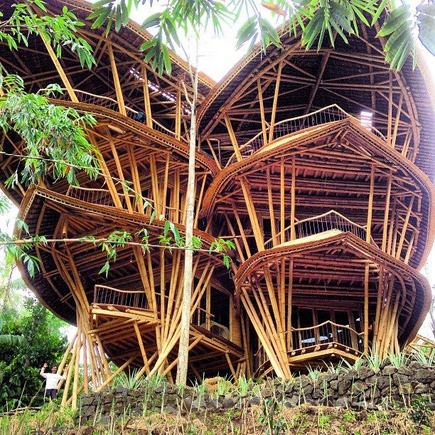 Ginormous bamboo house designed by @alorahardy Green village bali. Note the tiny man in lower left corner