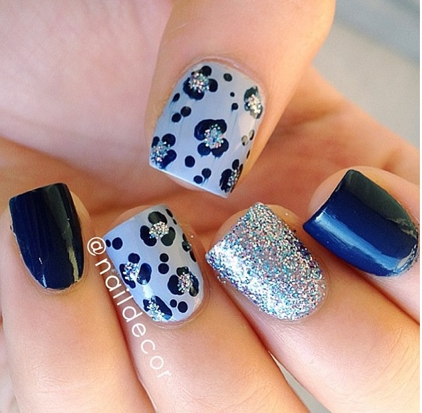 Navy blue, silver glitter, and leopard printed nails.