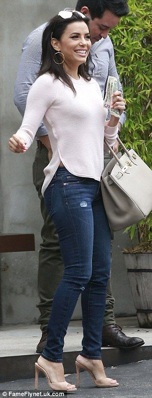 Two different looks: Eva Longoria donned white sweats for her shopping trip and changed into jeans for a lunch date with pals in Los Angeles on Thursday