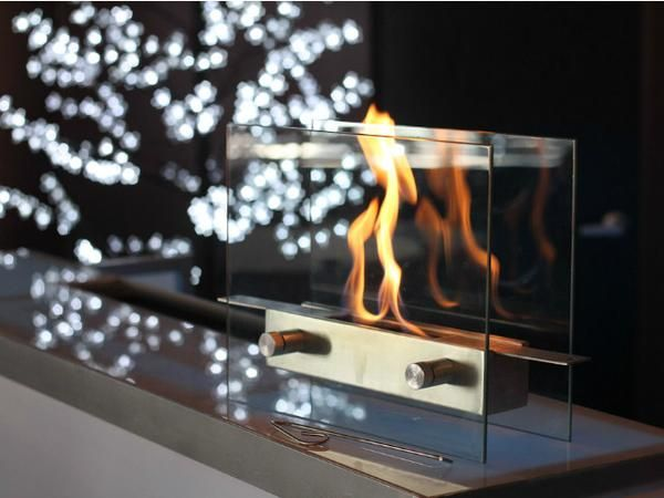 This new super chic, Anywhere Fireplace™ Metropolitan model brings the ambiance of fire to small spaces. Its sleek tempered glass front and back and stainless steel fuel burner can be put on any steady surface – a table top, a stand, the floor or inside non-functioning fireplace to finally allow you to see the beautiful dancing flames of a fire where you previously could not. Its clear glass design allows you to view the mesmerizing flames from any angle.