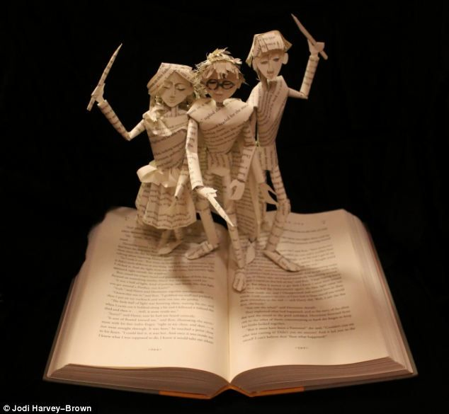 Unique: Artist Jodi Harvey-Brown began creating book sculptures like this one of Harry Potter, Ron and Hermoine, because she wanted to bring her favourite characters to life