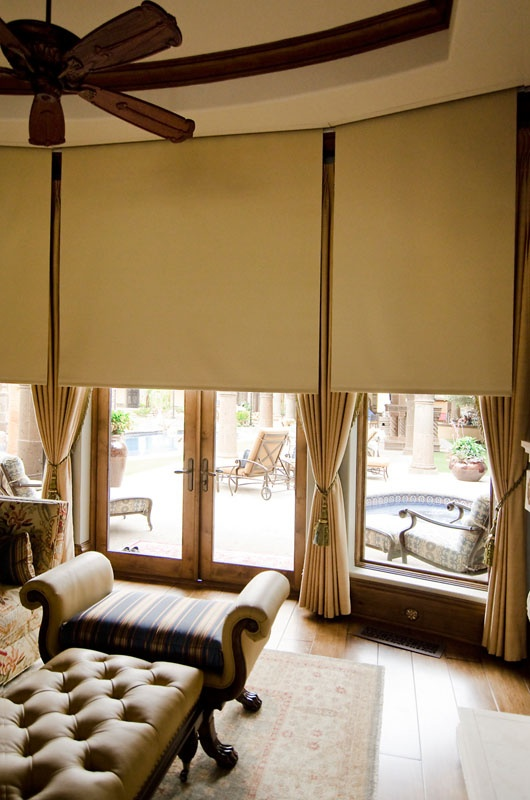 sunout blackout roller shades placed over drapes installed into a ceiling pocket to